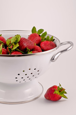 Strawberries in a White collander